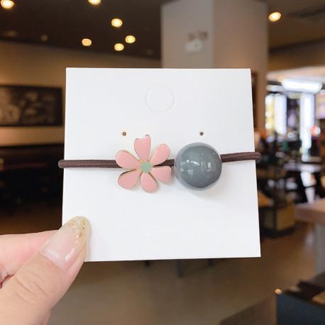 Резинка, коричневая. Розовый цветок и бусинка.
